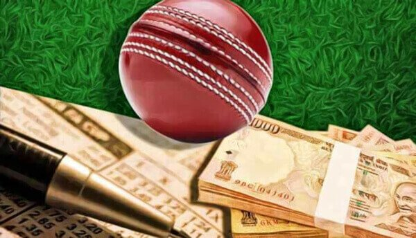 rupees beside a cricket bat and ball