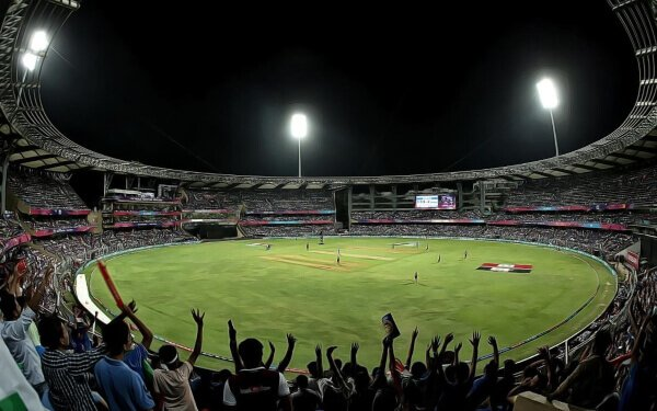 fans cheering for cricket players in an indian cricket ground